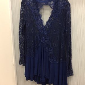 Free People Lace Flowy Top fits a medium